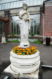 Old statue with flowers Royalty Free Stock Photography