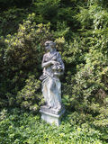 Old statue in the garden Stock Image