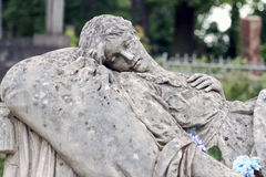 Old statue on grave in the Lychakivskyj cemetery of Lviv, Ukrain Royalty Free Stock Image