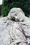 Old statue on grave in the Lychakivskyj cemetery of Lviv, Ukrain Stock Photo