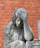Old statue on grave Royalty Free Stock Photography