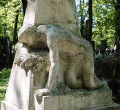 Old statue on grave Stock Image