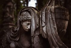 Statue on grave in the old cemetery Royalty Free Stock Photo