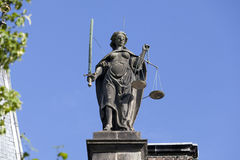 Old statue of Lady Justice Stock Images