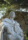 Old statue of the man standing in the park in Lisbon Royalty Free Stock Image