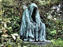 Old statue of person wearing robe Royalty Free Stock Photo