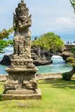 Old statue at Pura Tanah Lot Royalty Free Stock Images
