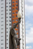 Old statue and street light with modern building, Manaus. Classic old statue and street light with modern building in the background. Details of the opera of Royalty Free Stock Image