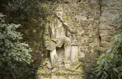 Old statue of thinking man Stock Photo