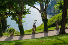 Old statue in villa Balbianello stock photography