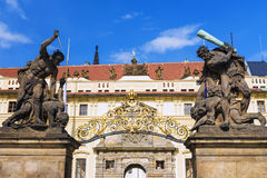 Old statues decorate the western gate to the Prague Castle, Czec Stock Image