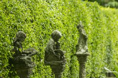 Old statues in the garden stock images