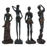 Old statuettes of African women Royalty Free Stock Photo