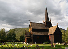Old stave church in the Norwegian countryside Stock Photos