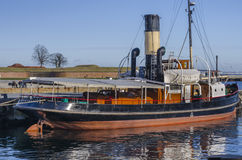 Old steam boat docked in the harbour Royalty Free Stock Image