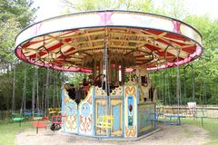 Old steam driven fairground attraction. Liphook, UK - 13 May, 2018: Old steam driven fairground attraction at the Hollycombe Steam Fair. One of several restored Royalty Free Stock Photography