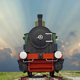 Old steam engine locomotive train on beautiful sky background Royalty Free Stock Image