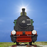 Old steam engine locomotive train on beautiful sky background Stock Image