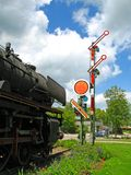 Old steam locomotive. Steam locomotive in front of a signal Stock Photo