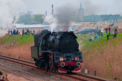 Old steam locomotive. WOLSZTYN, POLAND - MAY 02, 2010: On the first weekend of May each year train enthusiasts from across the world descend on Wolsztyn to watch Royalty Free Stock Image