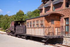 Old steam locomotive. With wooden wagon Stock Image