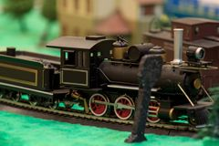 The old steam locomotive carries the freight train. Toy railroad. Carefree childhood Royalty Free Stock Images