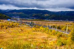 Old steam locomotive in the Circum-Baikal Railway with smoke in autumn. Old steam locomotive in the Circum-Baikal Railway with smoke in cloudy wearther autumn Royalty Free Stock Image