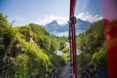 An old steam locomotive is climbing up the'schafbergbahn' on to the top of the Schafberg