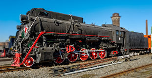 Old steam locomotive in the depot Stock Images