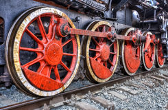 Old steam locomotive engine wheel. And rods details Royalty Free Stock Photo