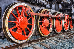 Old steam locomotive engine wheels. And rods details Royalty Free Stock Image