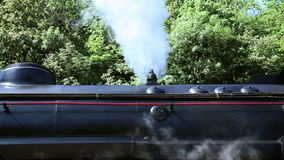 Old steam locomotive On first smoke is going out from exhaust. Two diferent close up shots of an old steam locomotive. On first smoke is going out from exhaust stock footage