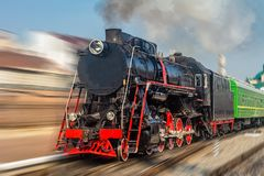 Old steam locomotive. Old black and red steam locomotive with motion blur stock photo