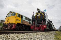 Old steam locomotive Pacific. NAKHON PATHOM, THAILAND - AUGUST 12 : Diesel Electric locomotives and Old steam locomotive pacific park correlate On Mother's Day Stock Photography
