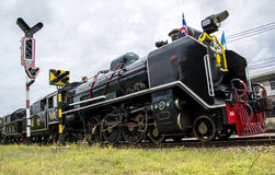 Old steam locomotive Pacific. NAKHON PATHOM, THAILAND - AUGUST 12 : Old steam locomotive Pacific of State Railway Thailand No. 850 and 824. On Mother's Day at Stock Images