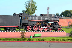 Old steam locomotive on the pedestal Royalty Free Stock Images