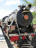 Old steam locomotive on the railway. Railway with Steam Train, still active on a sunny day, in the interior of Brazil Stock Image