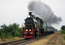 Old steam locomotive travels by rail Stock Photos