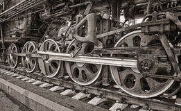 Old steam locomotive wheels. Old steam locomotive engine wheel and rods details Royalty Free Stock Image