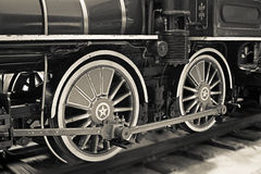Old steam train wheels in black and white Stock Photos
