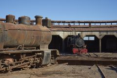 Baquedano Engine Shed, Chile. Old steam locomotives at the historic engine shed at Baquedano Railway Station in the Atacama Desert, Chile stock photography