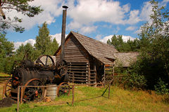 Old steam machine staying in backyard royalty free stock image