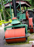 Old steam roller machines for laying of asphalt Stock Images