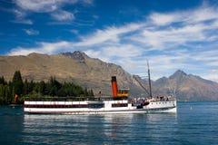 Old steam ship on a lake. TSS Earnslaw cruises lake Wakatipu. South Island, New Zealand royalty free stock photos