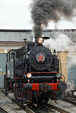 Old steam soviet locomotive. Low key photo. Vintage style. Red star and lettering USSR Stock Photo