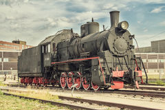 Old Steam Train. The old steam locomotive in the depot Royalty Free Stock Image