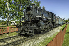 Old steam train. Old black steam train with the locomotive in the foreground royalty free stock image
