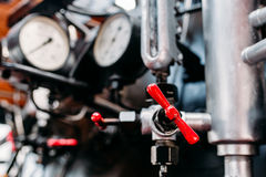 Old steam train cabine, valves, pipes closeup Stock Photos