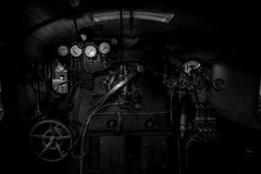 Old steam train control panel black and white image Stock Images