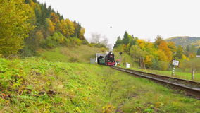 Old Steam Train. Old Steam Engine Train Leaving Tunnel stock footage